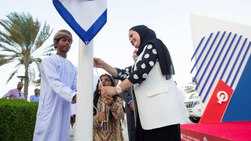 HE Maitha Al Mahrouqi Raising IODA flagسعادة ميثاء المحروقية ترفع علم البطولة إذاناً بإنطلاقتها