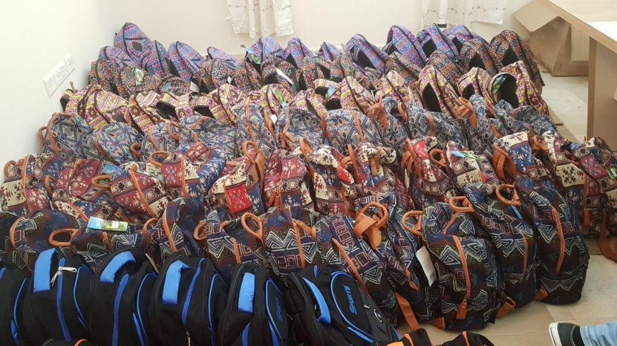 توزيع حقائب مدرسية على 600 طالب وطالبة من الأسر المعسرة بمسقط