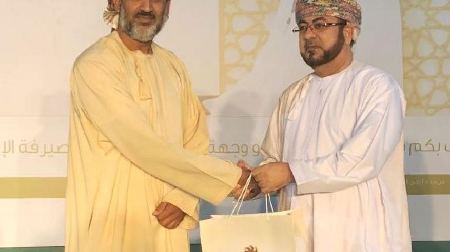 Head of Sohar Islamic Giving Away Prizes