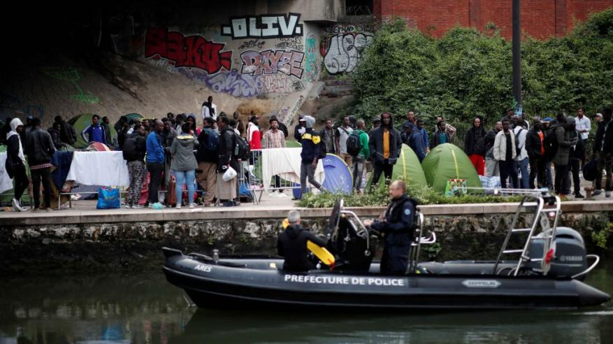 French-police-evacuates-migrants_Reuters-1024x683