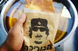 """بالفيديو والصور.. افتتاح مطعم """"معمر القذافي"""" في إسرائيل"""