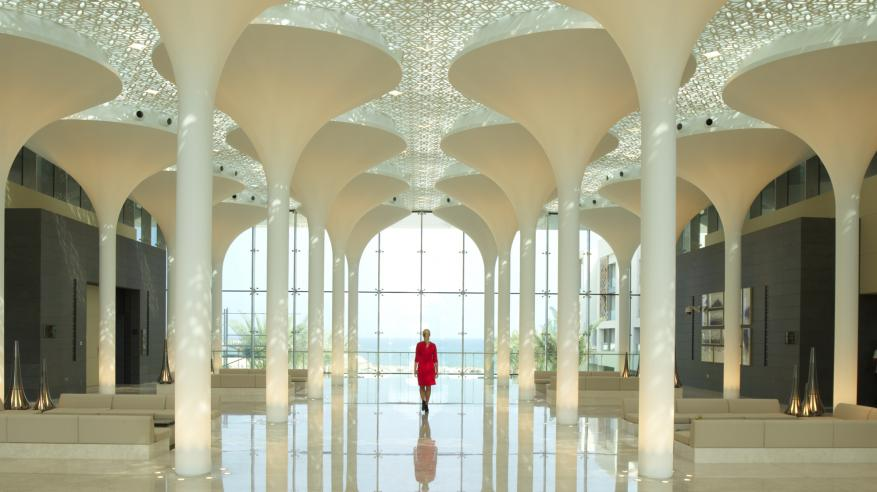 Kempinski Hotel Muscat_Lady in Red at the Lobby