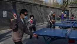 الصين تعلن رفع قيود التنقل عن  معقل كورونا.jpg