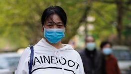 الصين تعلن زيادة في حالات الإصابة الجديدة بفيروس كورونا ووفاة شخص يوم الأحد.jpg