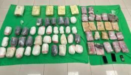 الشرطة تضبط شخصين بحوزتهما 63 كيلوجراماً من المخدرات.jpg