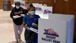 تصويت انتخابات أمريكا ترامب بايدن كورونا كمامة.jpg
