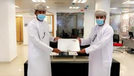 Handing over project completion certificate to Al Waha Team.jpg